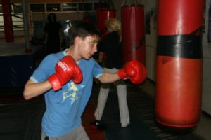 red gloves young boxer